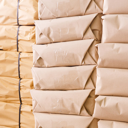 strapping: Stack of parcel wrapped in brown recycled paper and tied with PP strapping band