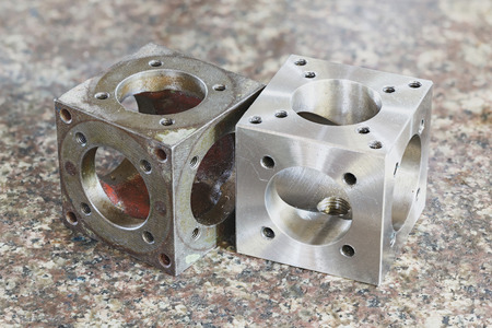 Compare new stainless steel turning part with old original