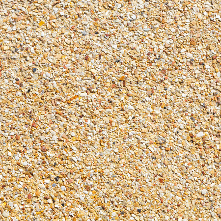 Close up yellow color rough gravel floor photo