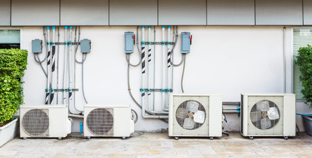 Close up air conditioner heating units installation outside of building