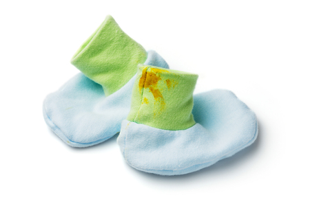 excreta: Dirty of feces on baby socks isolated on white
