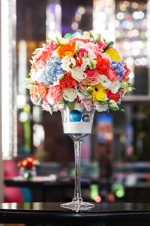 Close up flower bouquet on table in wedding ceremony photo