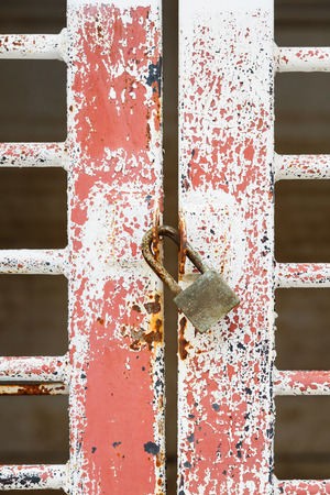 Close up old and dirty door and rusty pad lock  photo