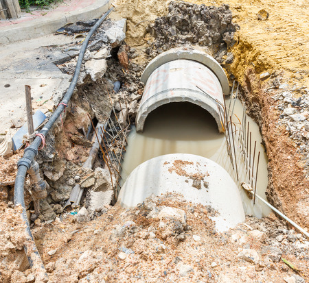 Close up sewer installation beside footpath in city  photo