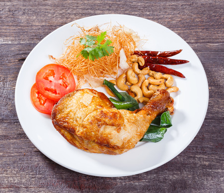 Close up deep fried chicken with lemon grass herb  photo