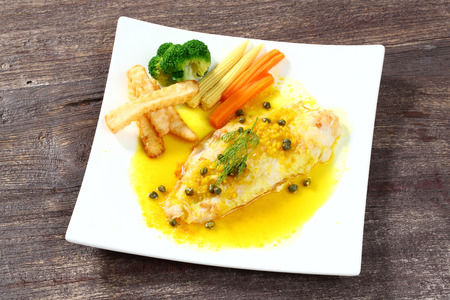 Close up dolly fish steak with lemon sauce photo