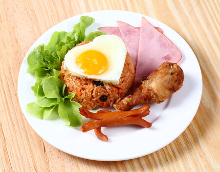 bacon love: Close up American fried rice served with green cos lettuce Stock Photo
