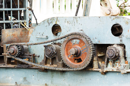 piling: Close up dirty old gear and chain on piling machine