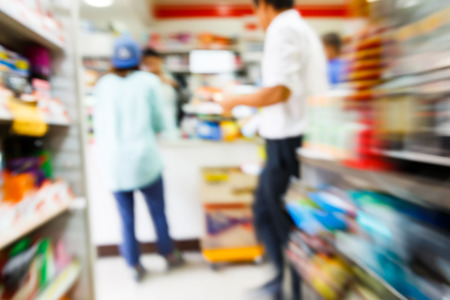 convenient store: Blurry convenience store shot by moving camera with slow shutter speed