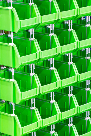 storage bin: Close up stacks of green color plastic storage bin