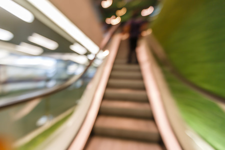 Blurred moving escalator shot by slow shutter speed photo