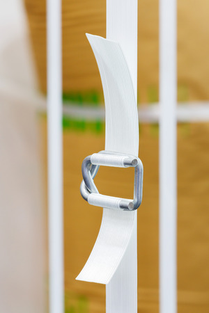 heavy duty: Close up heavy duty white color nylon strapping with metal buckle