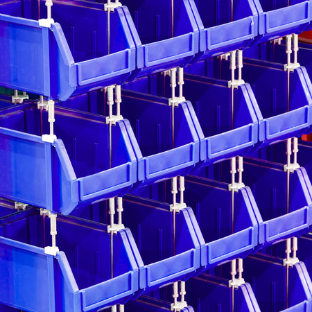 storage bin: Close up stacks of blue color plastic storage bin Stock Photo