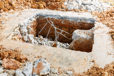 Close up square hole digging on old concrete floor photo