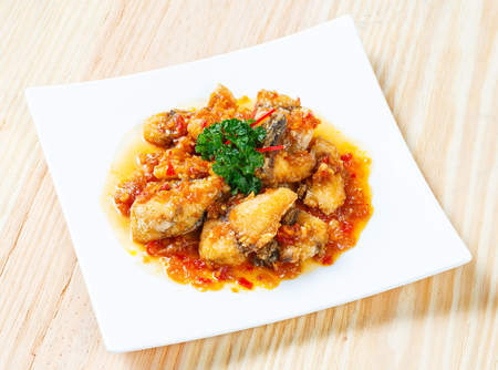 silver perch: Close up deep fried grouper fish spicy sweet and sour sauce Stock Photo