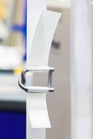 strapping: Close up heavy duty white color nylon strapping with metal buckle