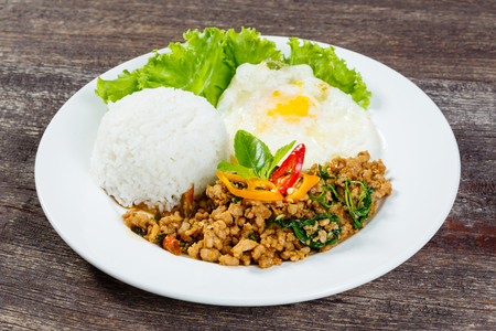 topped: Close up Rice topped with stir fried minced pork and basil Stock Photo