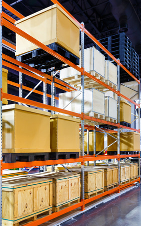 Close up paper and wooden cargo box on steel shelf system in warehouse Standard-Bild