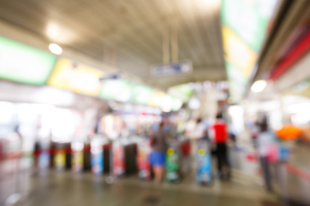 Abstract blurred people using automatic ticket gates at train station photo