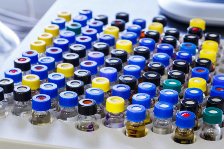 spectrometry: Vials with inserts and crimp septum caps in plastic rack for liquid analysis