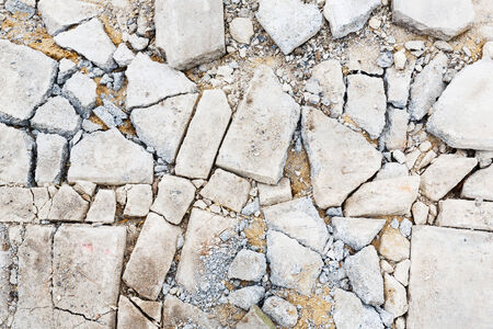Close up damaged cracked concrete floor in construction site photo
