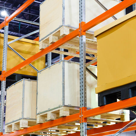 Close up paper and wooden cargo box on steel shelf system in warehouse photo