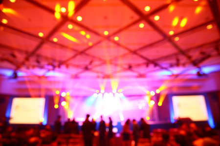 Abstract blurry light in convention event hall Standard-Bild