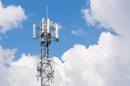 angle bar: Close up white color antenna repeater tower on blue sky Stock Photo