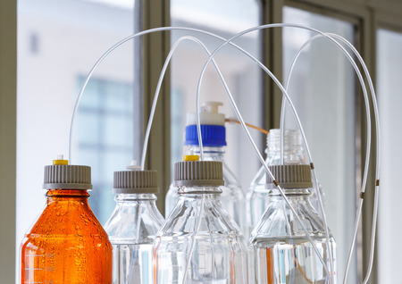 Close up clear and amber color bottle with plastic hose for High performance liquid chromatography - HPLC 스톡 콘텐츠