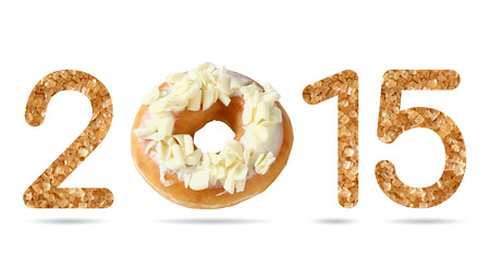 Close up 2015 numeric from natural sugar and donut topped by shredded white chocolate with shadow photo
