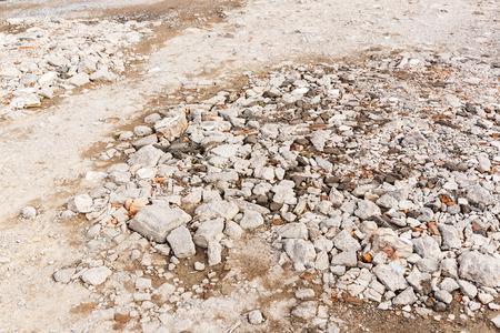 Close up rough bumpy stone road in rural photo