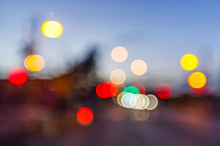Abstract blurry light from car lamp on street photo