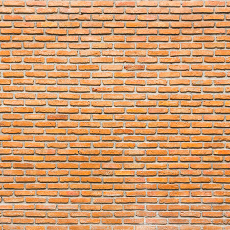 Close up red color brick wall texture background photo