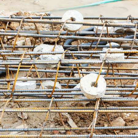 Close up Concrete covering on rusty rebar photo