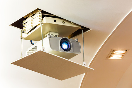 Projector hang on ceiling in meeting room photo