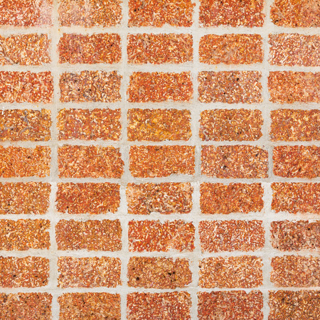 Close up old and weathered laterite wall tiles texture