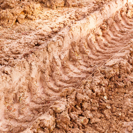 tire track: Close up tire track on red color lateritic soil Stock Photo