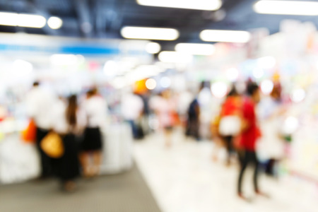 Abstract blurred people walking in shopping center photo