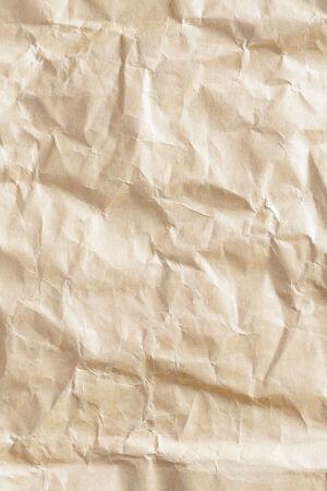 Close up crumpled brown color envelope paper texture photo