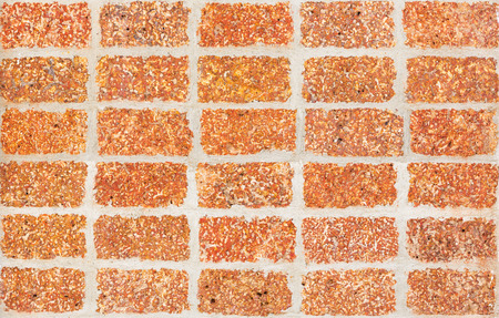 durability: Close up old and weathered laterite wall tiles texture
