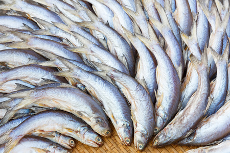dehydrated: close up dehydrated salted threadfin fish on bamboo woven tray Stock Photo