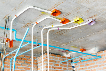 junction pipe: Close up electrical and sanitary distribution system installation in new building