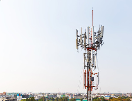 Close up antenna repeater cell tower in city photo