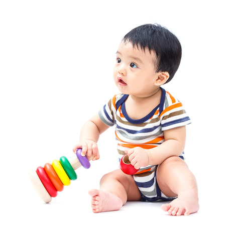 baby playing toy: Cute asian baby playing toy isolated on white