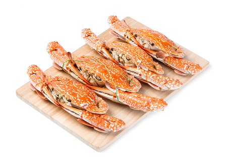 blue swimmer crab: Steamed flower crab served on wooden chopping board
