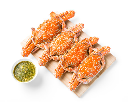 blue swimmer crab: Steamed flower crab served on wooden chopping board with spicy chili dip sauce