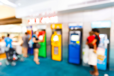 Abstract Blurry people with automatic teller machine or ATM in shopping centre photo
