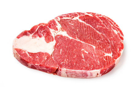 deep focus: Close up raw beef rib eye steak isolated on white - deep focus image