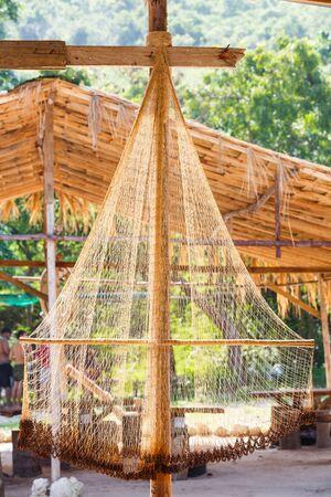fishingnet: Close up fishing net against sun light with blur background Stock Photo