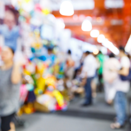 sidewalk sale: Abstract blurred people walking in shopping centre Stock Photo